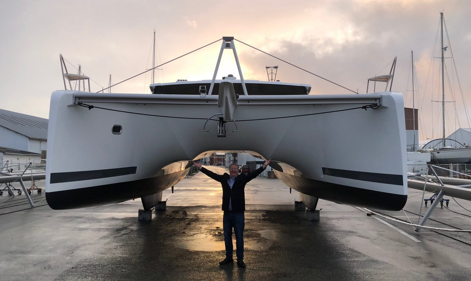 jim aron in front of a yacht
