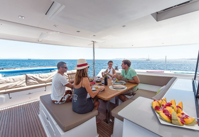 Friends enjoying lunch on a yacht