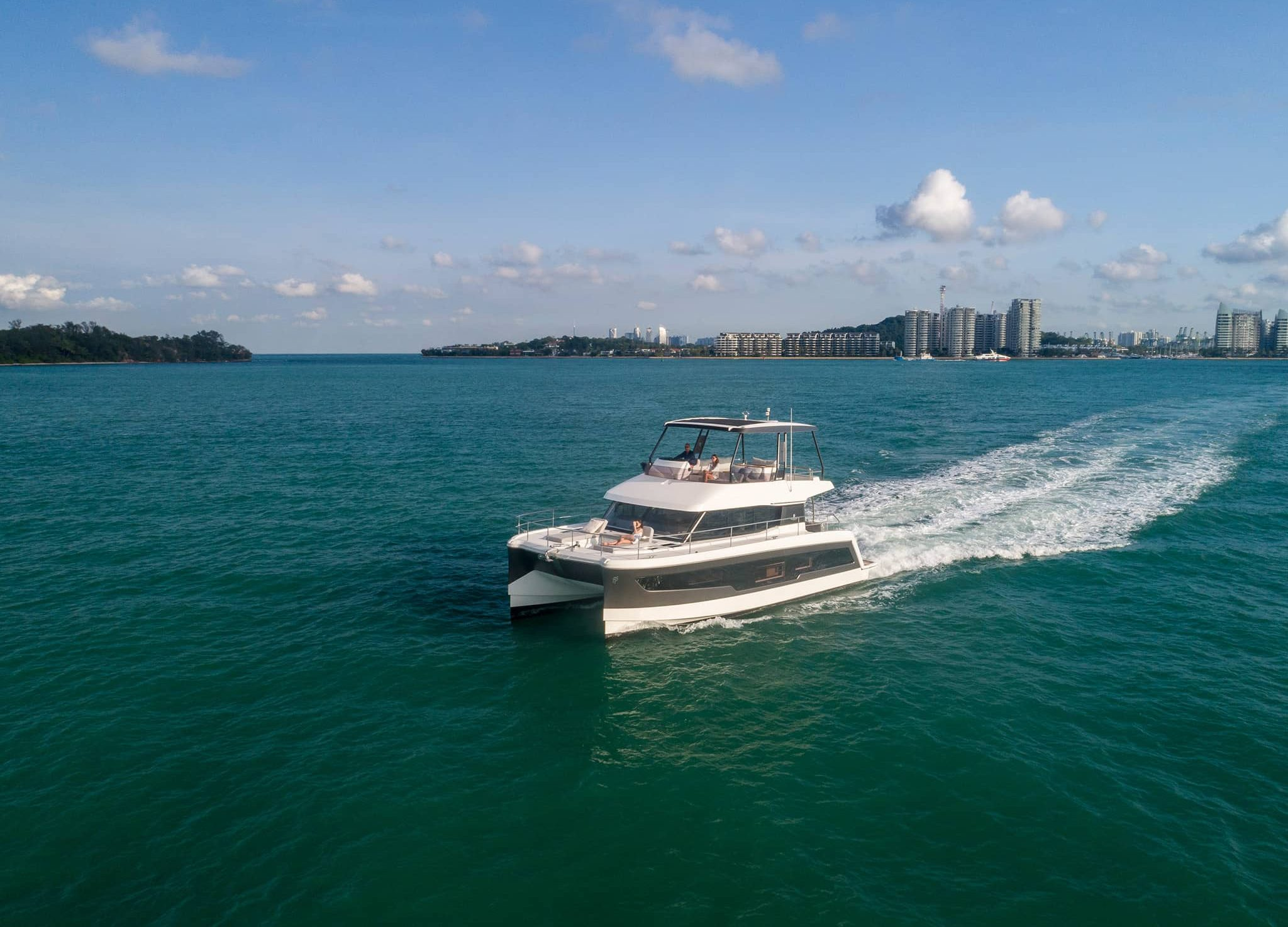 A Fountaine Pajot motor yacht cruising on an open body of water