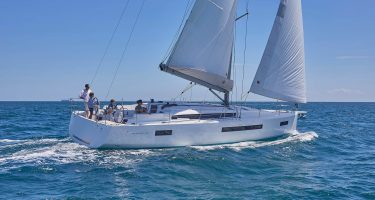 A Jeanneau 490 sailing on an open body of water