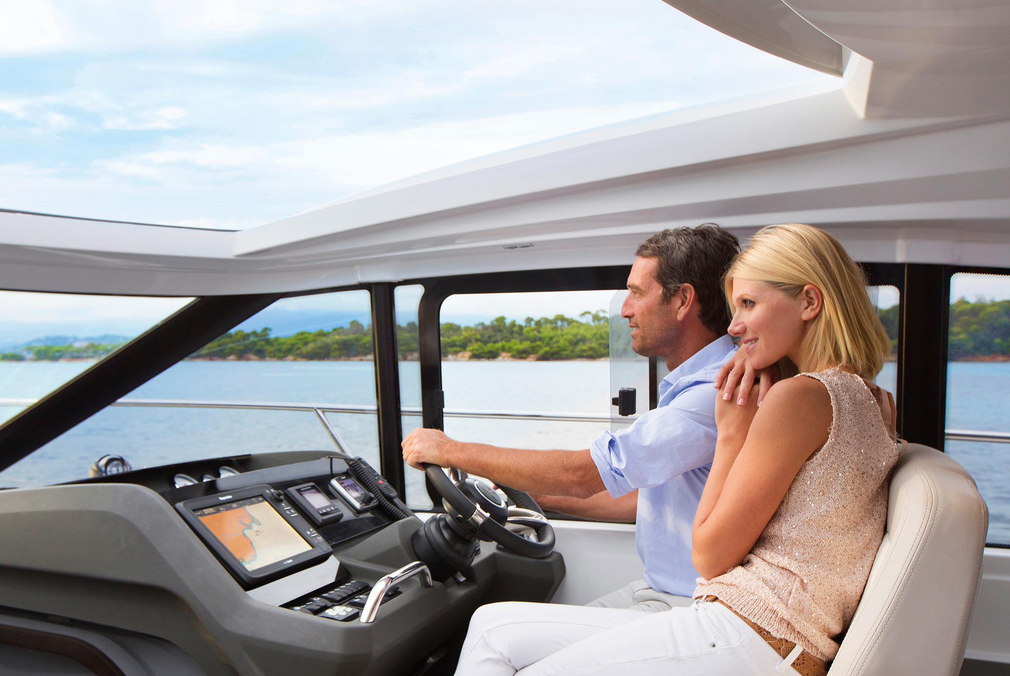 A man and woman cruising in a powerboat