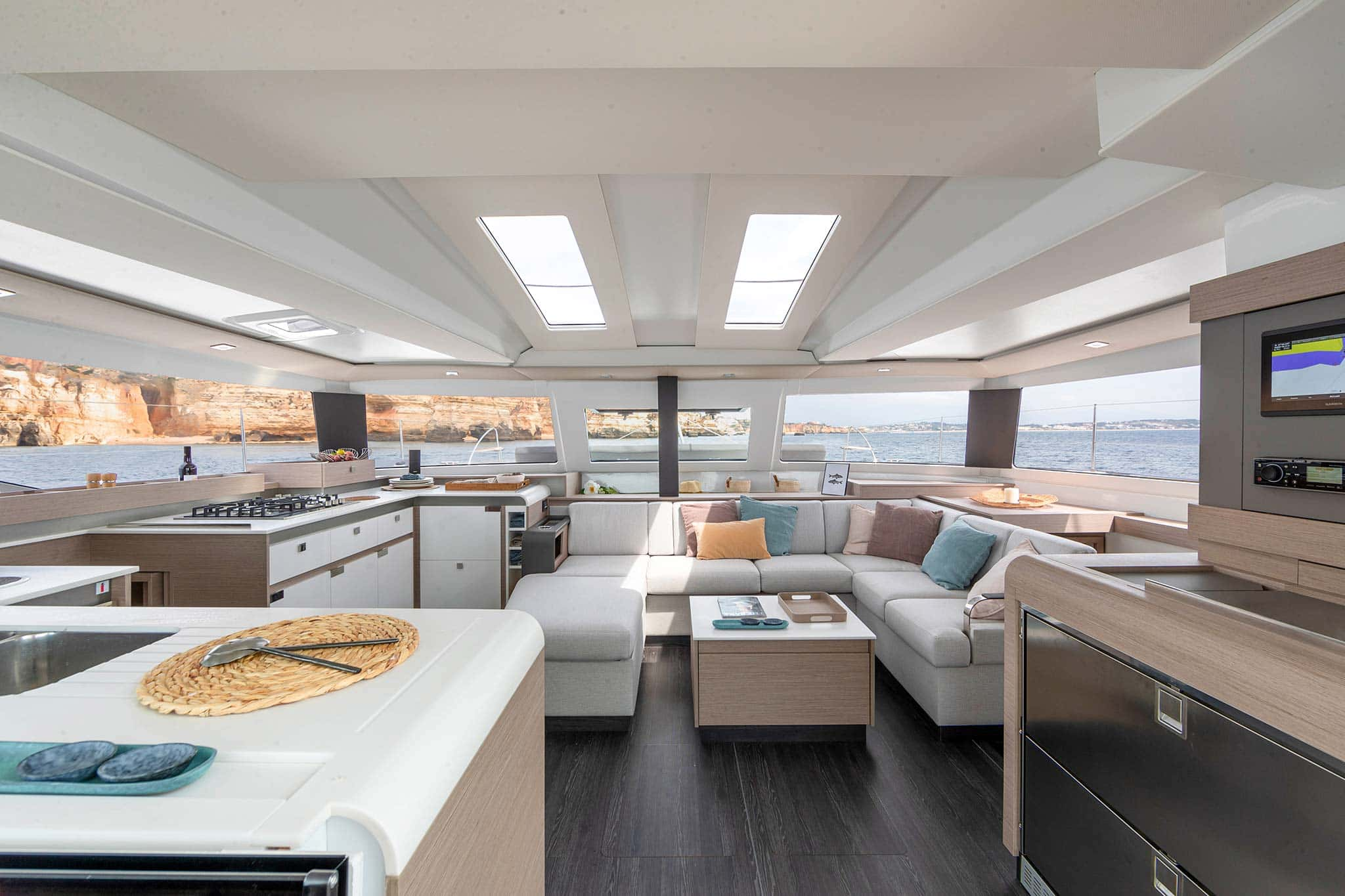 Seating and kitchen area of a commissioned yacht